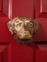 Golden Retriever door knocker on red door, lots of dog breed door knockers available